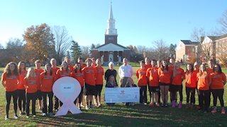 West Virginia Wesleyan swim teams make gift to breast cancer research