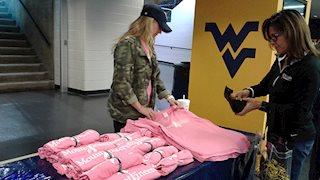 WVU gymnastics team raises breast cancer awareness