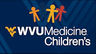 WVU Medicine Children's collecting items for patients at WVU Football game on Oct. 14