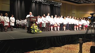 WVU School of Medicine students received white coats March 19