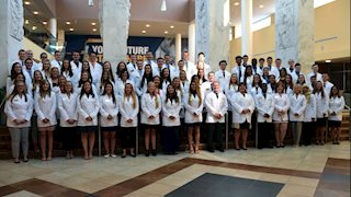 WVU School of Pharmacy first-year students receive white coats