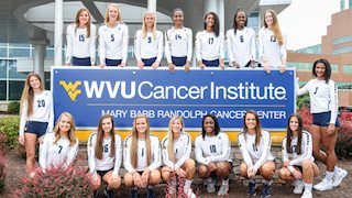"WVU volleyball team participates in ""Set for a Cause, Spike for a Cure"" to benefit cancer research"