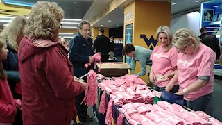 WVU women's basketball game raises breast cancer awareness and support for breast care center