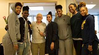 WVU women's basketball players visit cancer patients